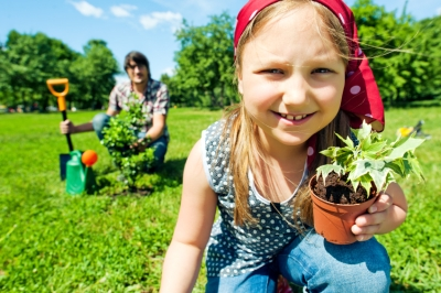 earth-day-activity-girl-planting-tree