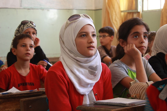 In the same class was Israa Wais who did not attend school last year because she lived in Al-Haydareh neighborhood where there were no functioning schools due to conflicts and clashes there.