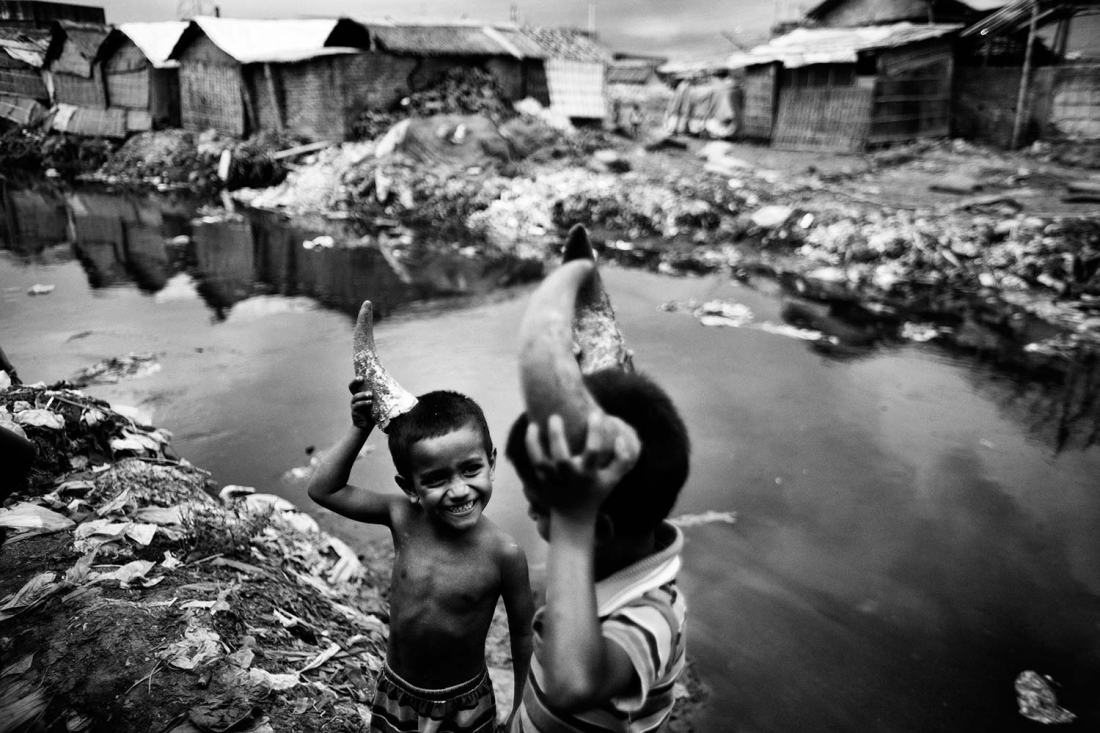 Kids play with animal wastes where trash and toxic chemicals fill canals which flow out into the Buriganga River. Hazaribagh was just listed in a report by Green Cross Switzerland and Blacksmith Institute as the 5th most polluted place on earth. It houses 95% of Bangladesh's leather tanneries, and every day 30,000 cubic liters of toxic waste are being dumped, including the cancer-causing chromium, into the capital city's main river and key water supply, the Burgiganga, in Dhaka, Bangladesh.