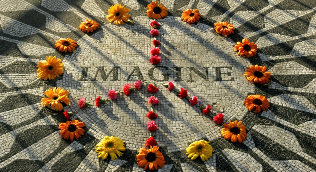 """A makeshift peace sign of flowers lies on top John Lennon's """"Strawberry Fields"""" memorial in New York's Central Park, Wednesday Dec. 7, 2005. The memorial is near the Dakota building where Lennon, a former member of the Beatles, lived with his wife Yoko Ono and son Sean when he was murdered outside the building. Thursday is the 25th anniversary of his death. (AP Photo/Bebeto Matthews)"""